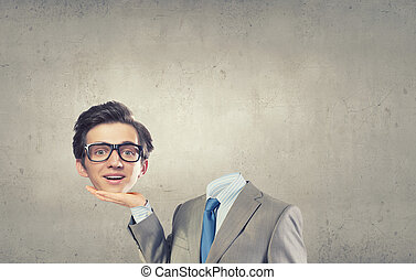 Headless businessman - Young headless businesman holding his...