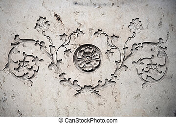 Ornament with botanical motives on an old sandstone wall