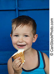 Little boy eating ice cream Tasty food