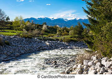 The river, snow mountains and green spring trees - Spring...