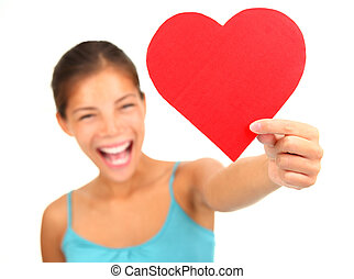 Valentines day heart - Woman holding Valentines Day heart...