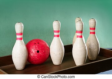 Bowling still life red ball over green background - Bowling...