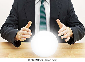 Fortune teller businessman predicting future with crystal...
