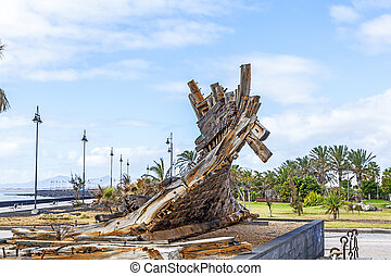 remains of old shipwreck in a park in Arrecife - remains of...