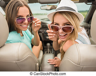 Friends in cabriolet - Cheerful young woman in cabriolet...