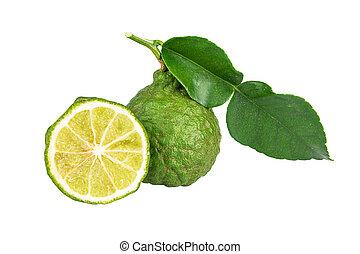 Bergamot. - Bergamot and kaffir lime leaves on white...