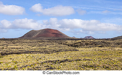 Landscape with cold lava flow in Lanzarote - Landscape with...