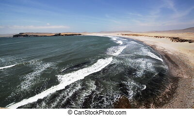 Paracas, Peru Beach - Waves coming in on a long deserted...