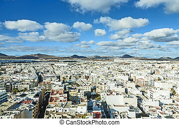 aerial view to Arrecife with volcanoes in the background -...