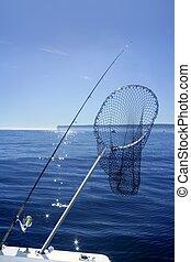 Fishing scoop net on boat in blue sea - Fishing scoop net on...