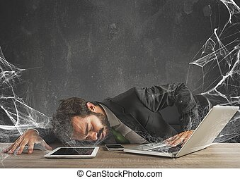 Trapped by technology web - Businessman trapped in a...