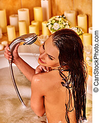 Young woman take bubble bath - Young woman take shower in...