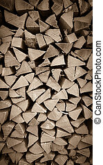Neatly stacked wood as background, vertical, close up
