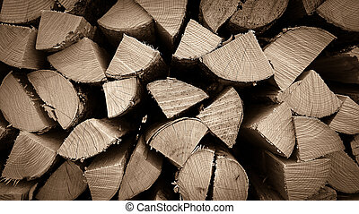 Neatly stacked wood as background, close up