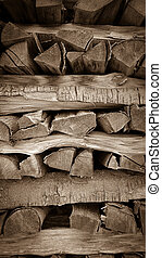 Neatly stacked wood as background, vertical