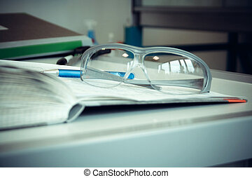 Thick Laboratory Journal with goggles, close up