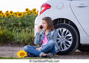 Young woman chatting on her mobile phone
