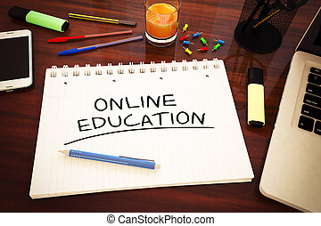 Online Education - handwritten text in a notebook on a desk...
