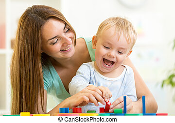 child and mom playing together with puzzle toy