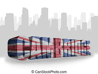 text Cambridge with national flag of great britain near...