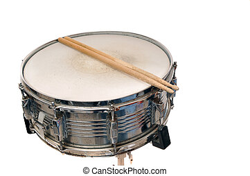 Snare drum with drum sticks on top isolated on white...