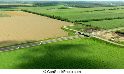 Aerial view of highway and field - aerial view of highway in...