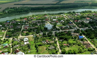 White church and river in Russian village aerial landscape -...