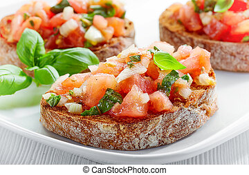 plate of bruschettas on wooden table