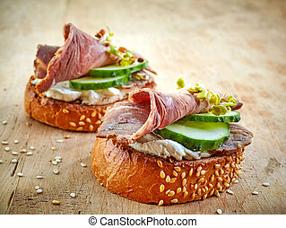 toasted bread with roast beef and cucumber - toasted bread...