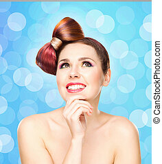 Beautiful smiling girl with a bow haircut and colorful...