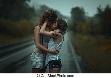 Girls standing in the rain on street - Girls standing in the...