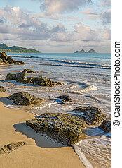 Bellows Beach - Rock outcropping at the shore of Bellows...