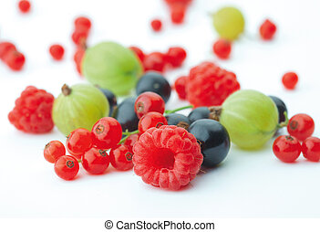 Spilled berries - Spilled mixed berries on white background...
