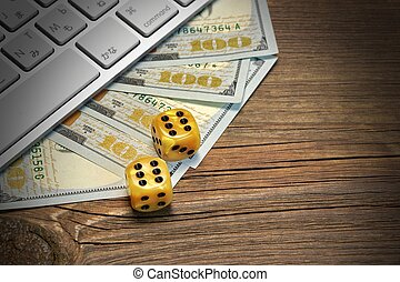 Computer Keyboard, Gaming Dices And Dollar Cash On Wood Background