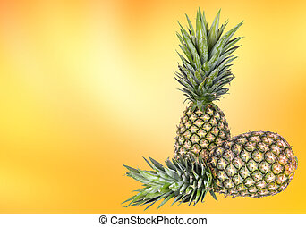 pineapples - Not yet ripe tropical pineapples on yellow...