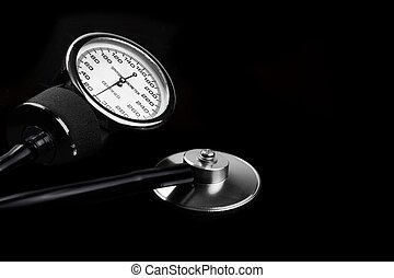 Manual Sphygmomanometer Isolated On Black Close-up - Manual...