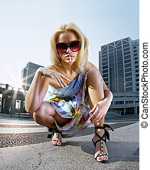 smoker blonde - Beautiful blonde woman on urban background...