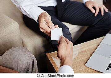 Giving visiting card - Male employee giving blank visiting...