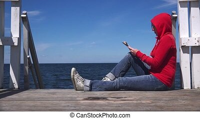 Young woman in red shirt reading - Young woman reading...
