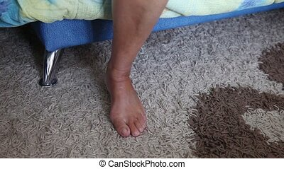 Women's Feet. Wake Up. - Female feet on the floor with the...