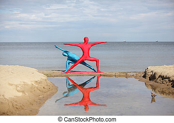 yoga in kaleidoscope at the beach, couple in anonymous...