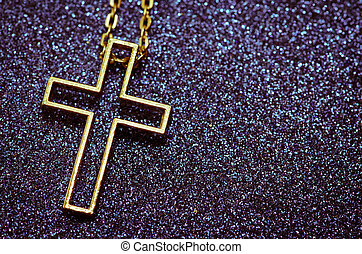 golden cross symbol over purple background
