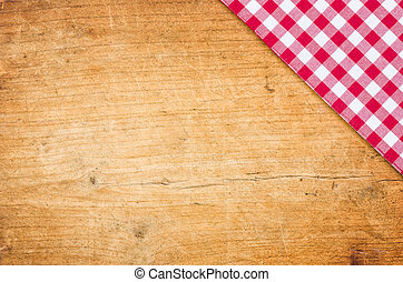 A wooden background with a checkered tablecloth
