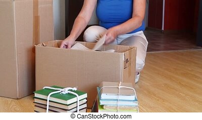 Woman Moving Into New Home And Unpa