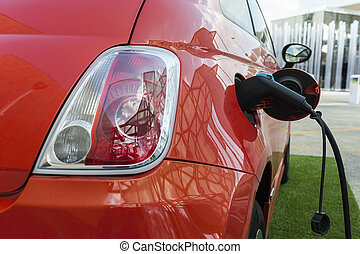 Electric car in charging station - Electric red car in a...