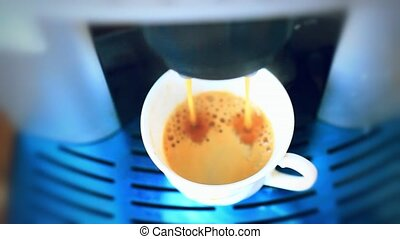 Espresso machine pouring coffee in cup - Fresh steaming...