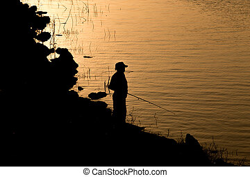 Angler - Man standing on fishing are silhouette. Country...