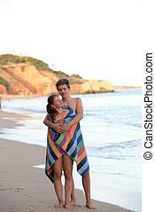 Happy young couple - Young couple standing together on the...
