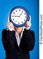 Clock Face - Portrait of a beautiful and young businesswoman...
