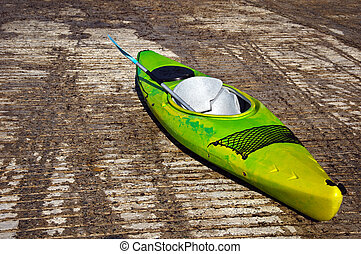kayak canoe on stone ramp outside - photo of kayak canoe on...